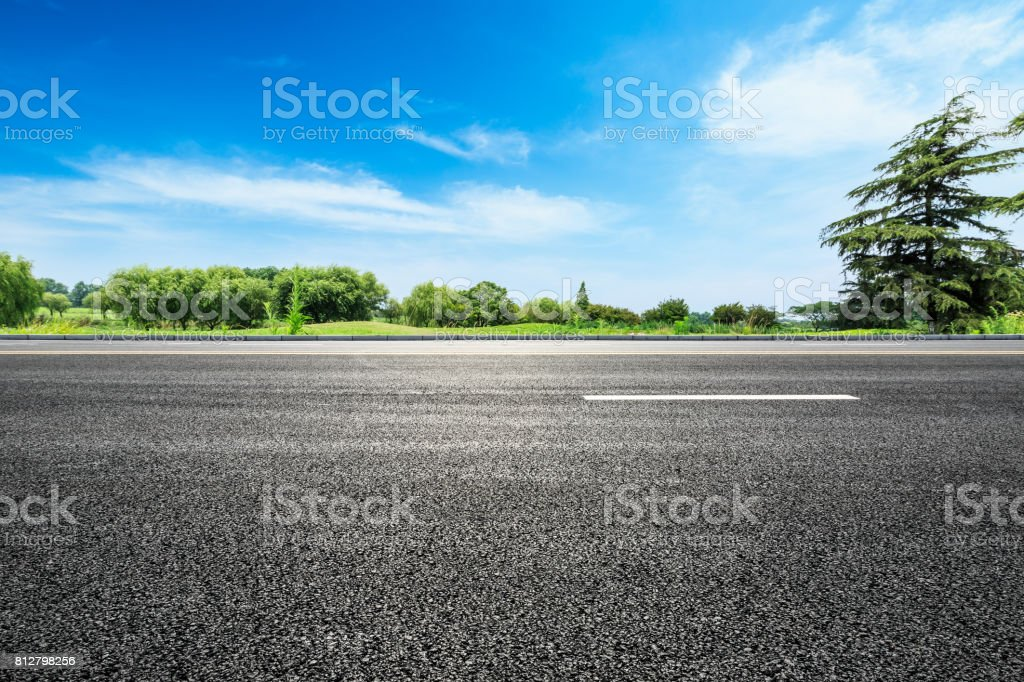 asphalt road and green tree in countryside stock photo