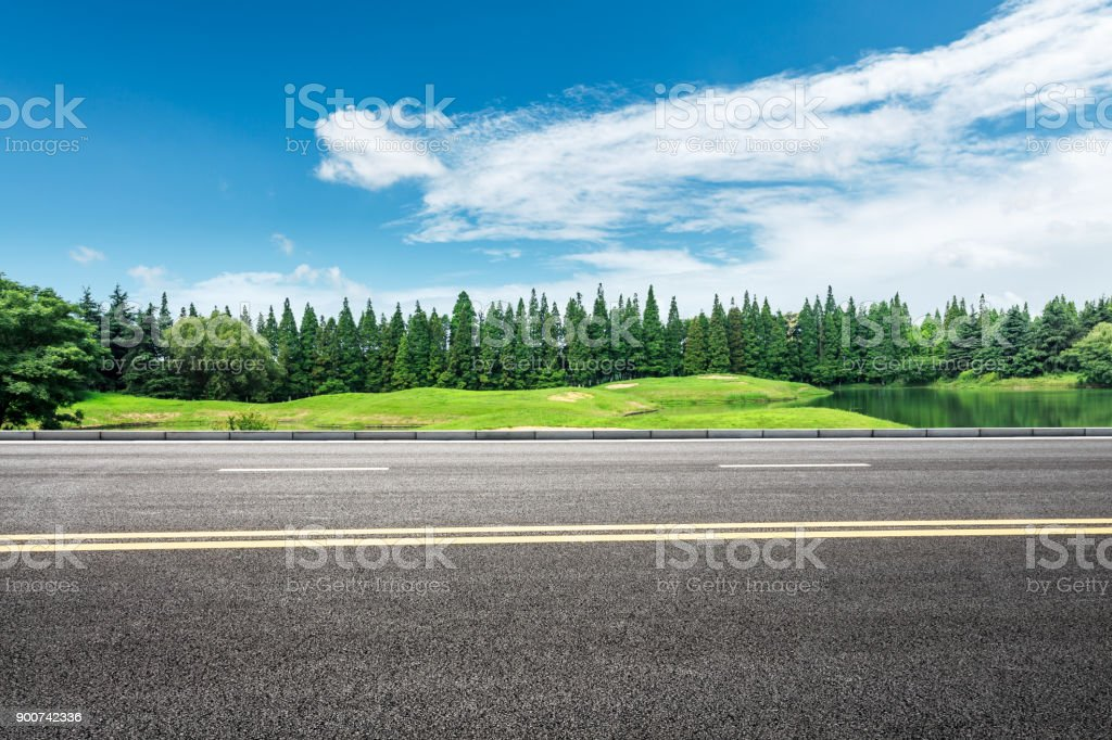 country asphalt road and green trees nature landscape in the summer