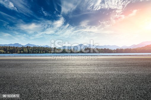 Asphalt road and hills with sky clouds landscape at sunset