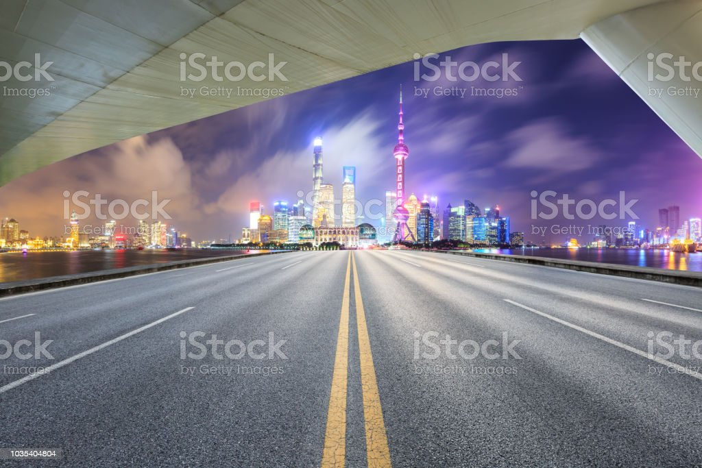 Asphalt road and modern city buildings in Shanghai at night stock photo