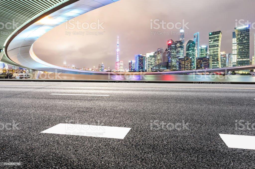 Asphalt road and modern city landmark building with bridge in shanghai stock photo