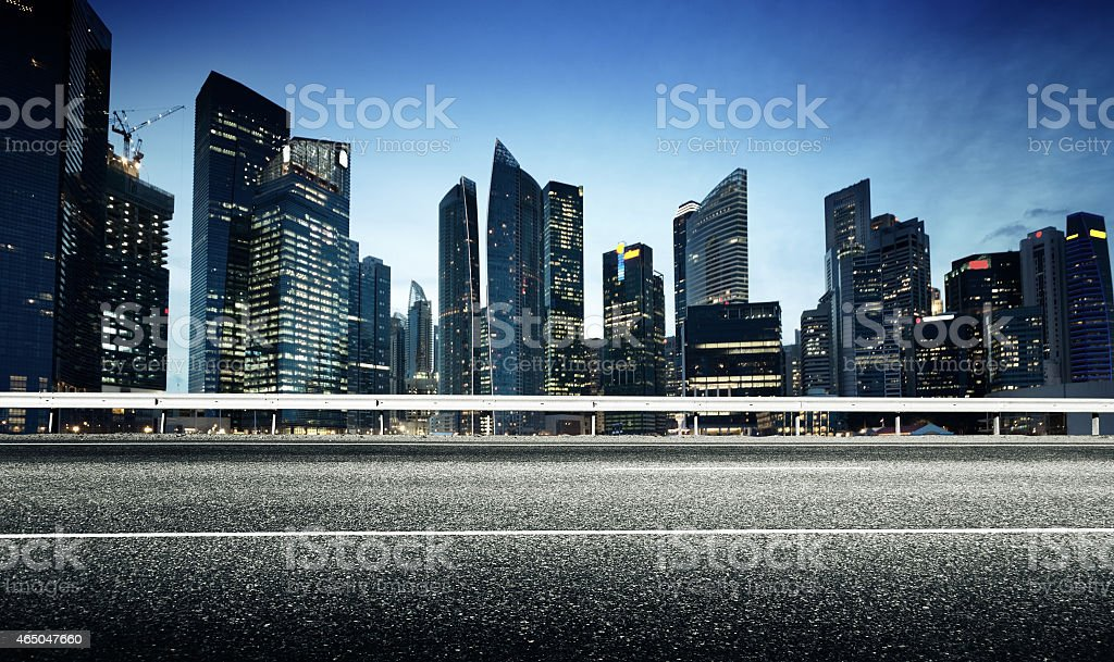 Asphalt road and modern city stock photo