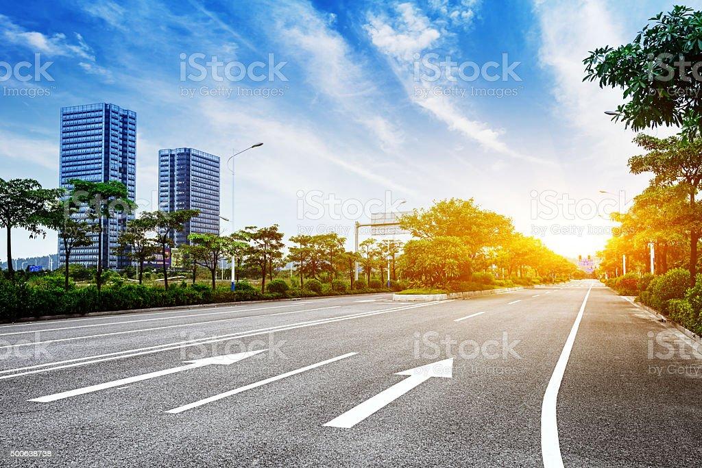 Asphalt road and modern city bildbanksfoto