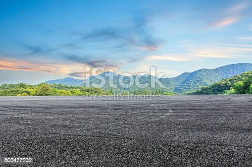 istock asphalt road and mountain background 803477232
