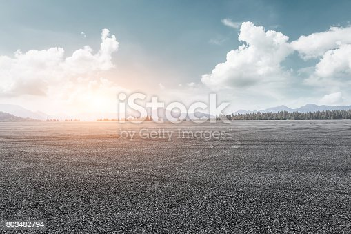 istock asphalt road and mountain background 803482794