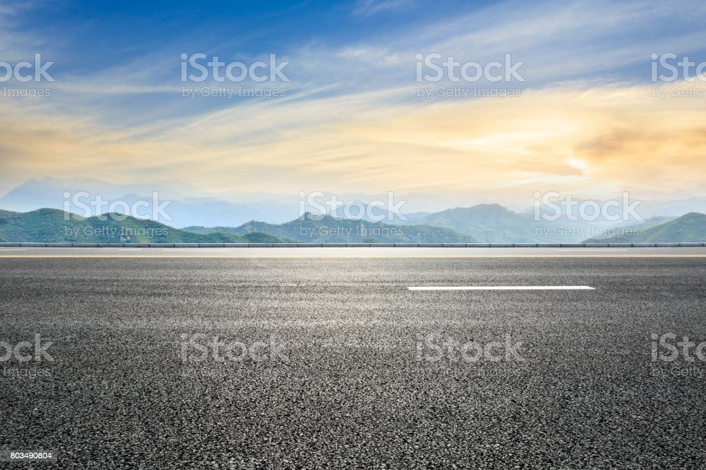 asphalt road and mountain background stock photo