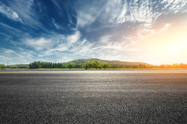 Asphalt road and mountain with clouds landscape at sunset Asphalt road and mountain with sky clouds landscape at sunset horizon over land stock pictures, royalty-free photos & images
