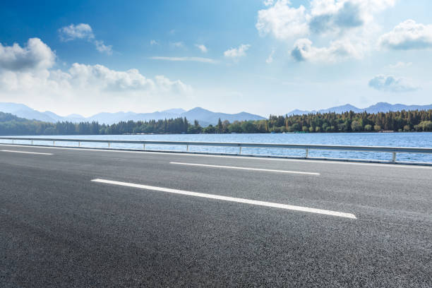 Cтоковое фото Asphalt road and mountains with lake landscape