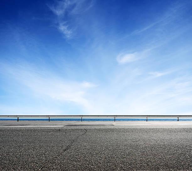 Asphalt road and sea coast line ストックフォト
