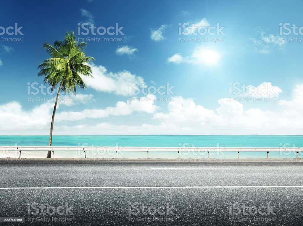 asphalt road and sea stock photo