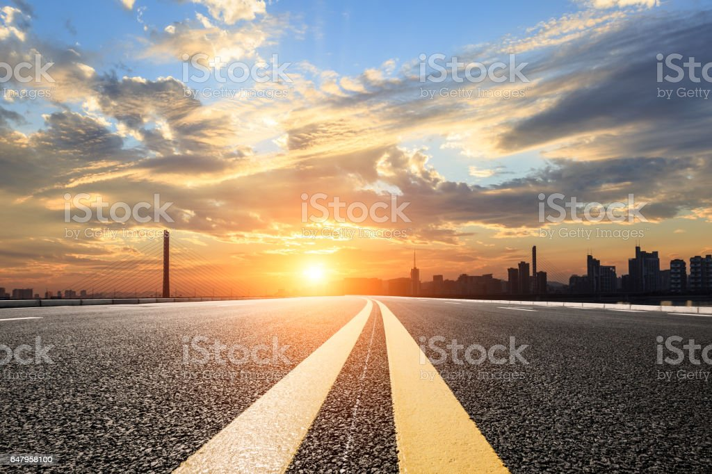 Asphalt road and sky at sunset stock photo
