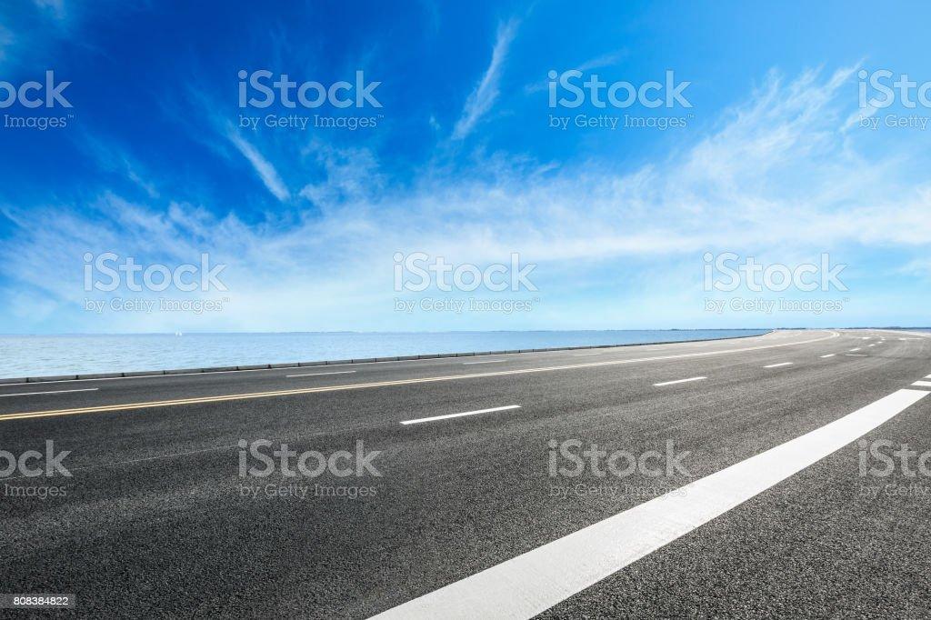 Asphalt road and sky cloud landscape stock photo