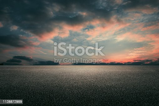 istock Asphalt road and sky clouds background 1128872959
