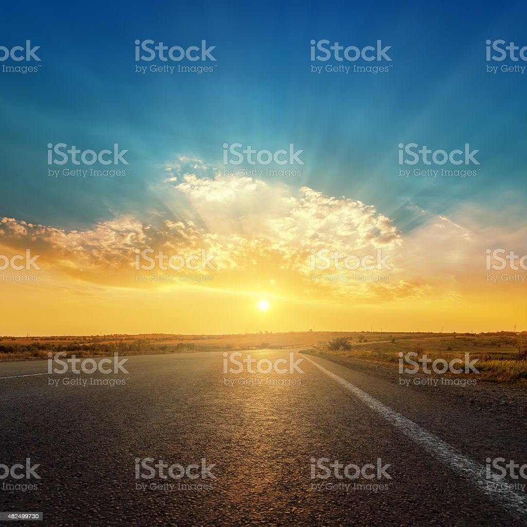 asphalt road and sunset in clouds stock photo