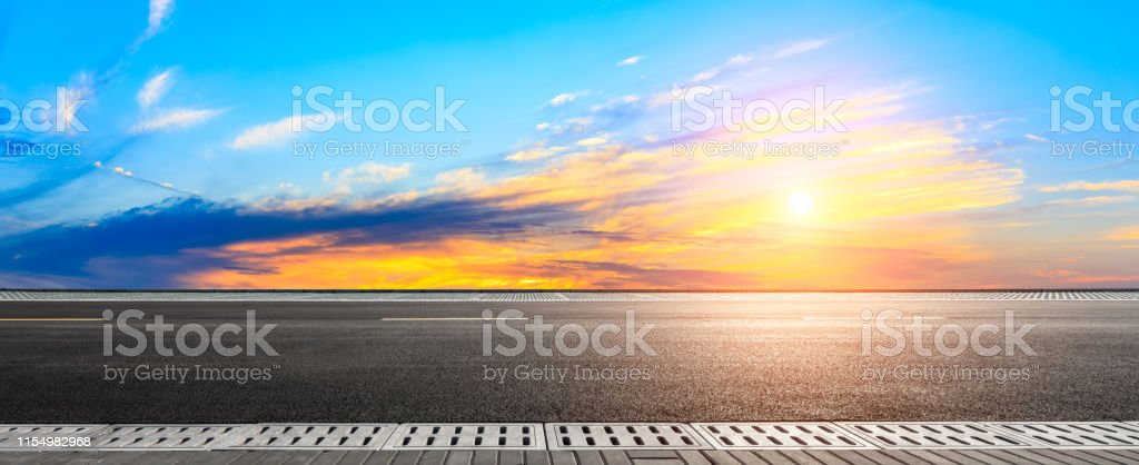 Empty asphalt road and sunset sky,panoramic view