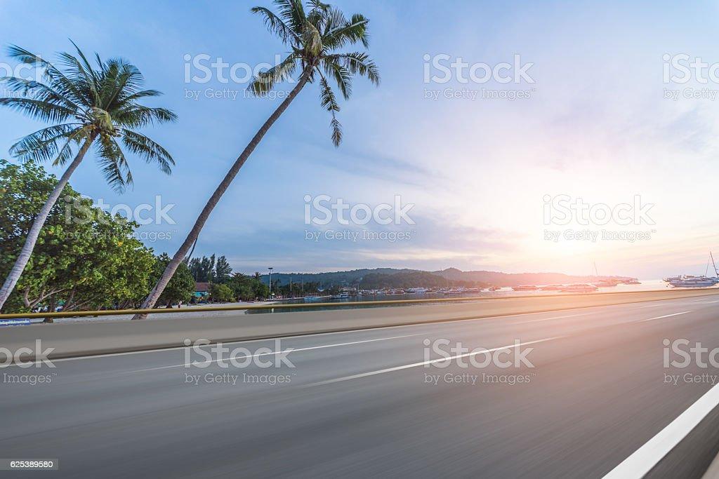 Asphalt road beside sea,Car Advertising background stock photo