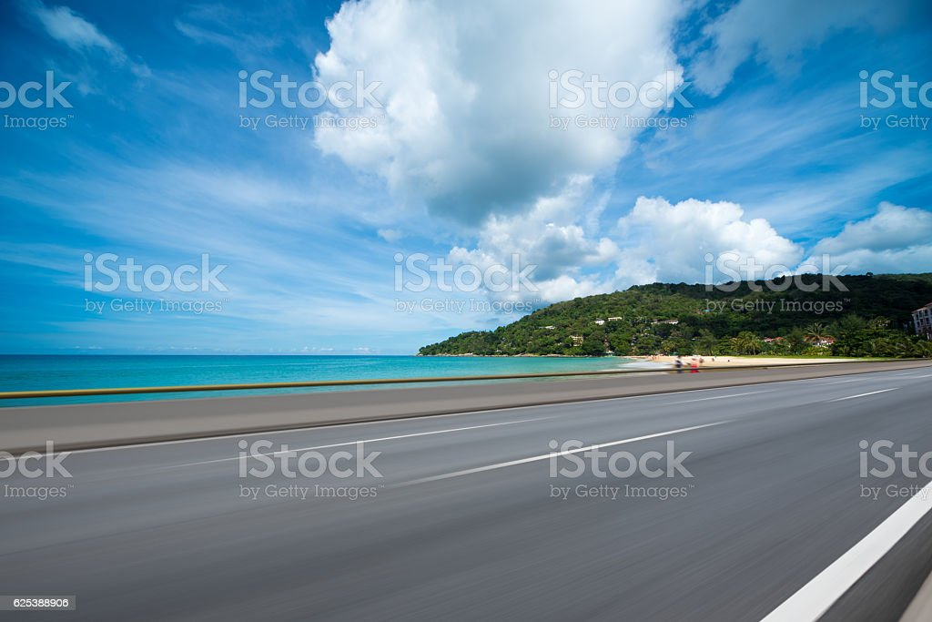 Asphalt road beside the sea,Car advertising background stock photo