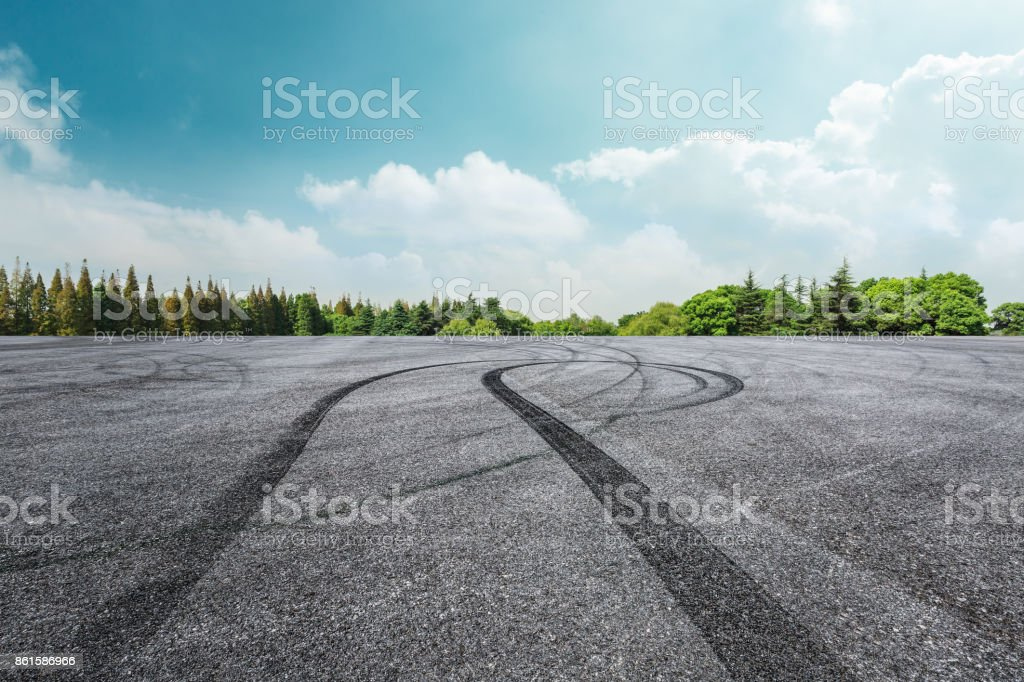Asphalt road circuit and sky clouds with car tire brake stock photo