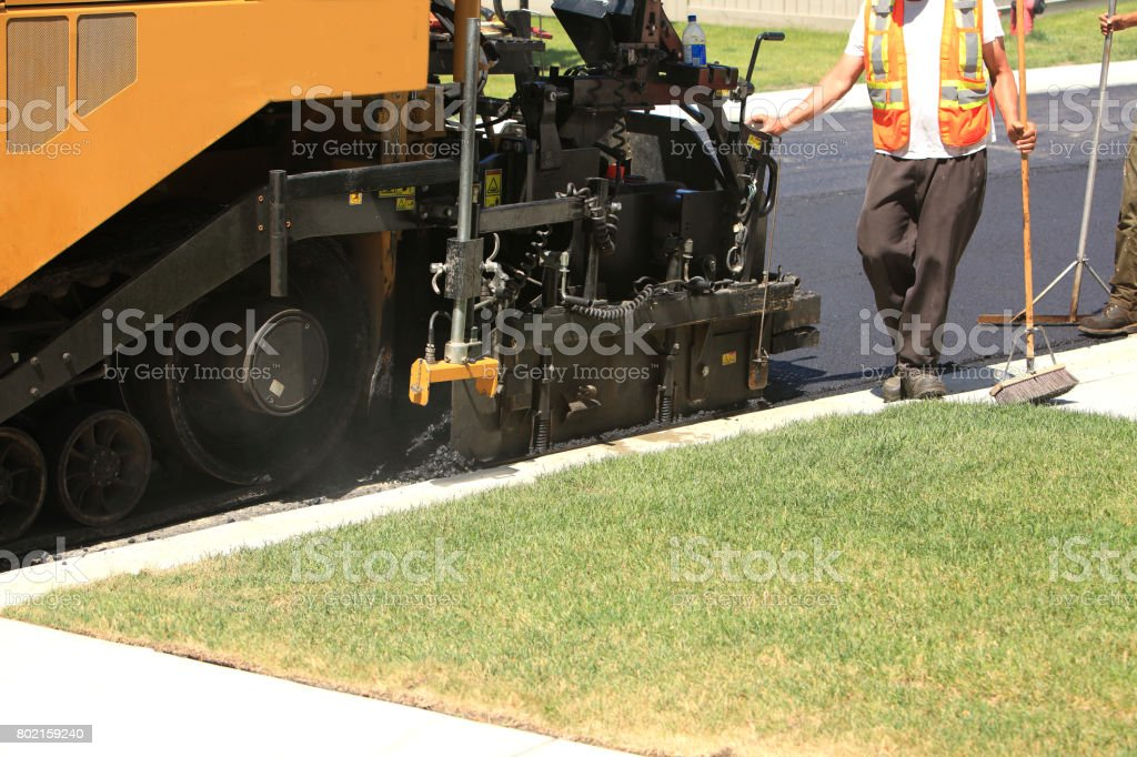 Asphalt Road Construction Machine And Workers stock photo