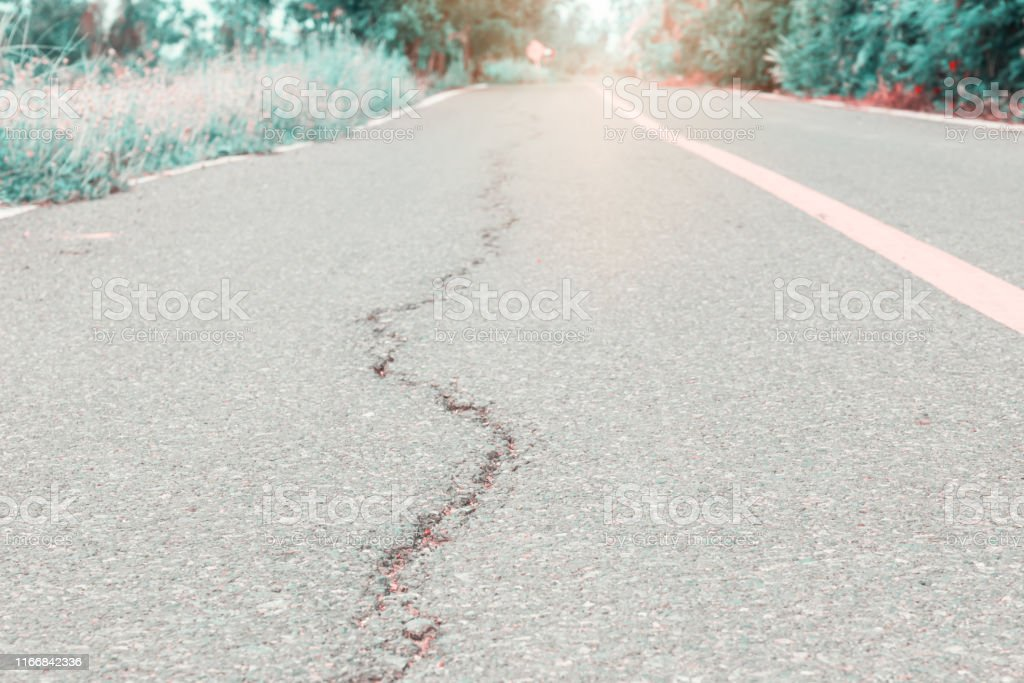 asphalt road cracked. street highway countryside