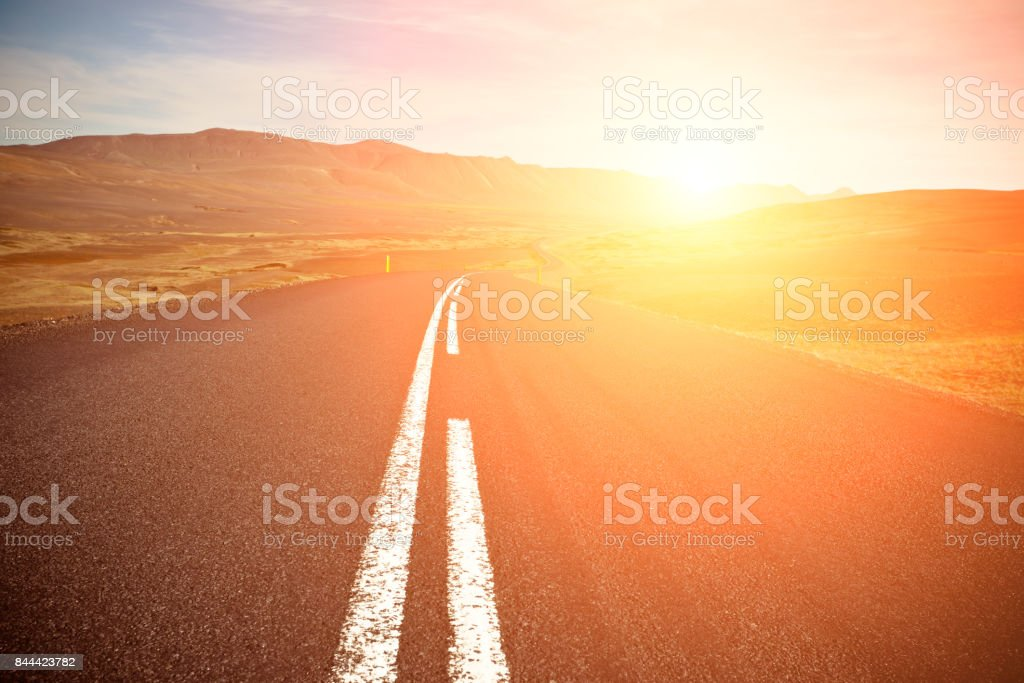 Asphalt Road field landscape with the bright solar effect stock photo
