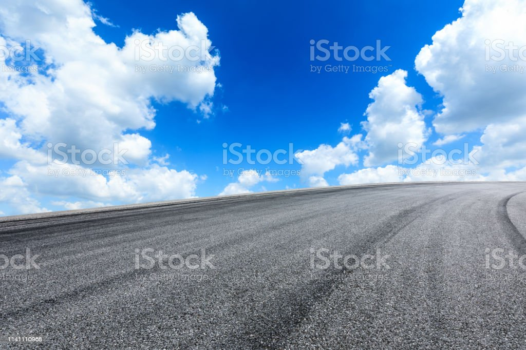 Empty asphalt road ground and blue sky with white clouds scene