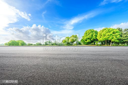 istock Asphalt road ground and green woods in the countryside nature park 1135220152