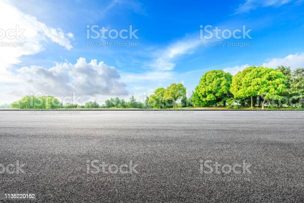 Photo of Asphalt road ground and green woods in the countryside nature park