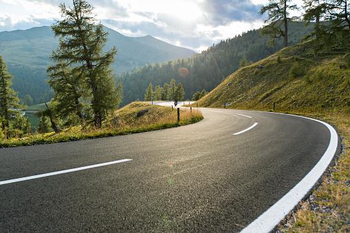 Asphalt road in Austria, Alps in a summer day