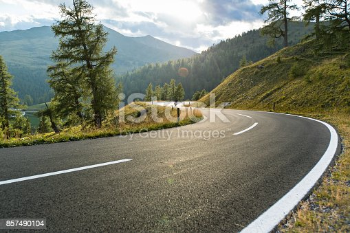 istock Asphalt road in Austria, Alps in a summer day 857490104