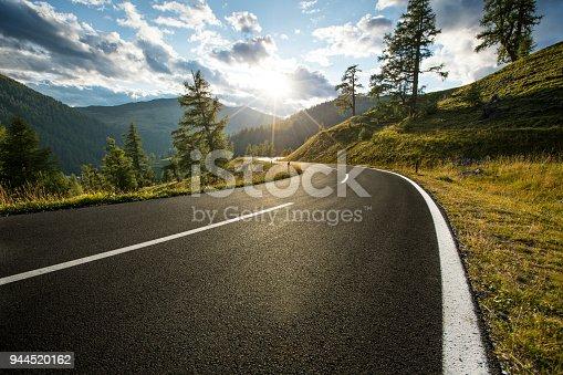 Asphalt road in Austria, Alps in a beautiful summer day, Nockalmstrasse.