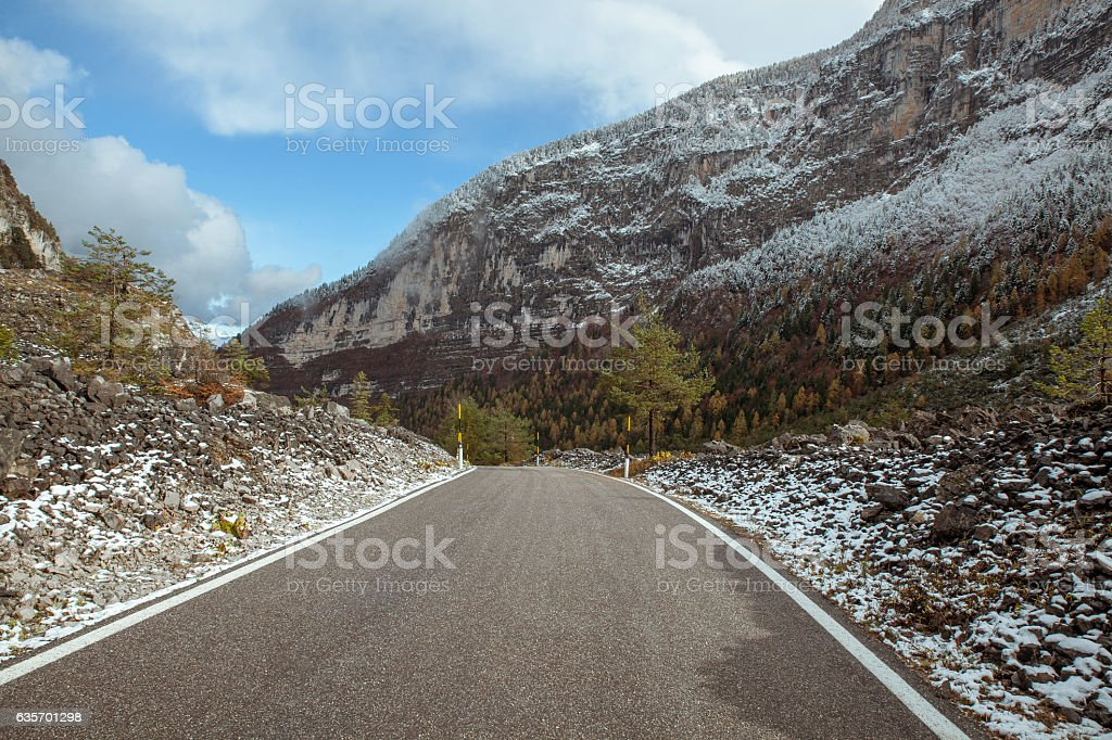 asphalt road in forest in mountains royalty-free stock photo