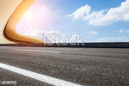 637668332 istock photo Asphalt road in front of modern bridge construction 637667910