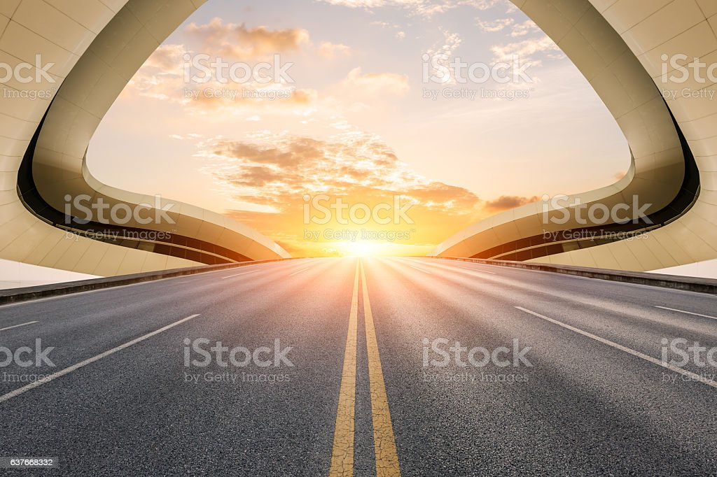 Asphalt road in front of modern bridge construction – Foto