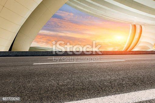 637668332 istock photo Asphalt road in front of modern bridge construction 637723242