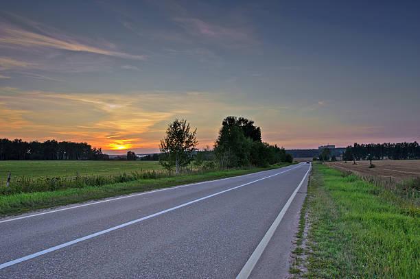 Asphalt road in sunset light stock photo