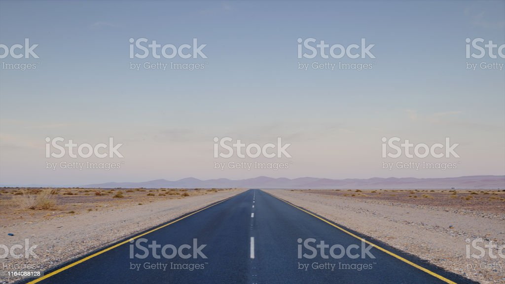 Asphalt road with dividing lines in the desert Namib-Naukluft Nature...