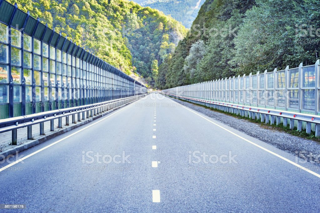 Asphalt road in the mountains. stock photo