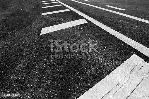 istock Asphalt road on arrow background. 604860662