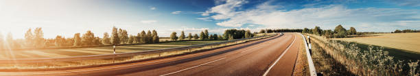asphalt road panorama in countryside on sunny summer day stock photo