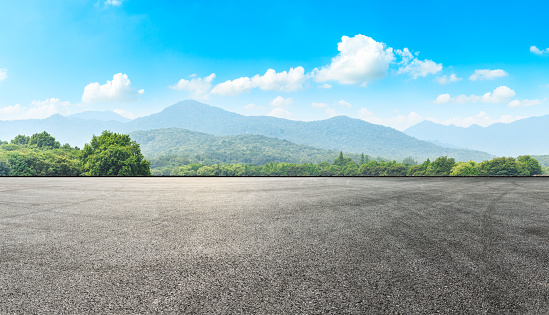 Asphalt road pavement and green mountain
