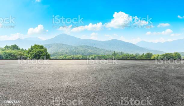 Photo of Asphalt road pavement and green mountain