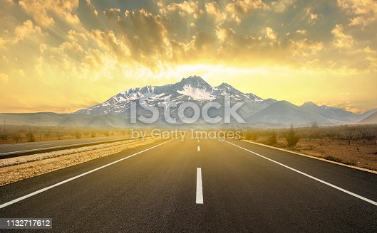 Asphalt road leading to the mountain