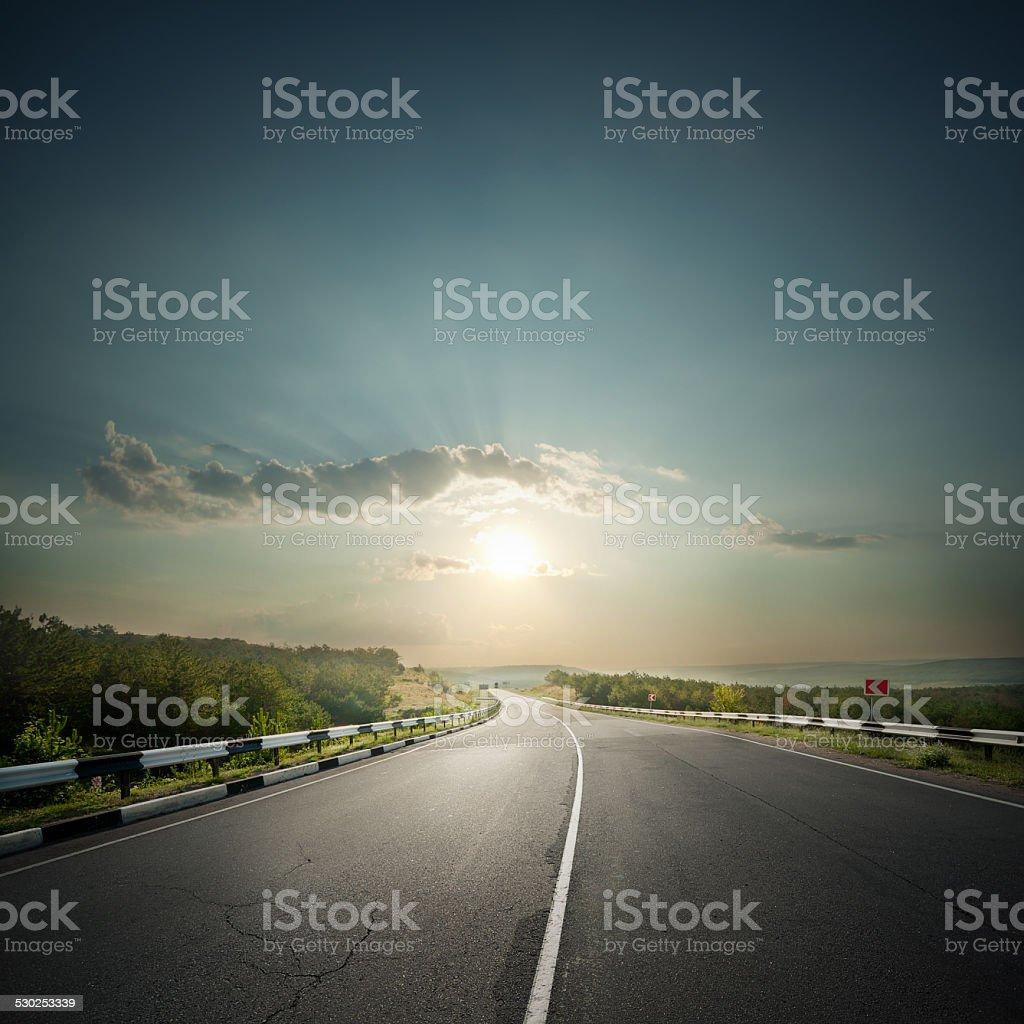Asphalt road receding into the distance stock photo