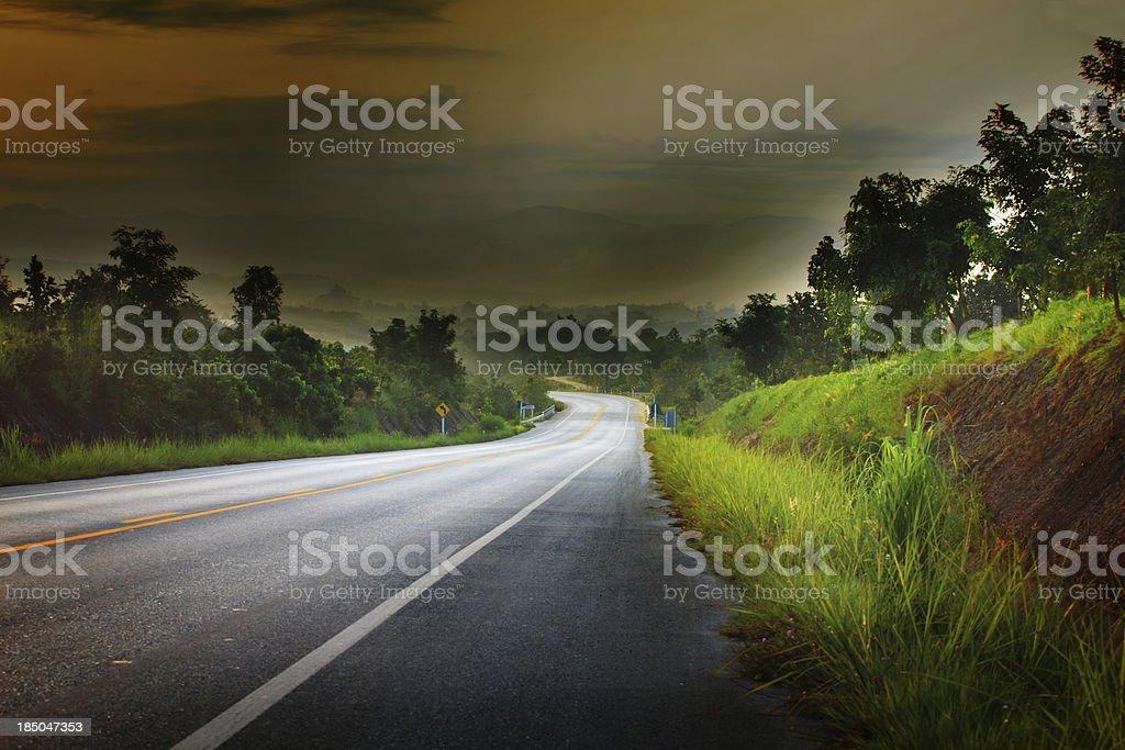 asphalt road run into the mountain royalty-free stock photo