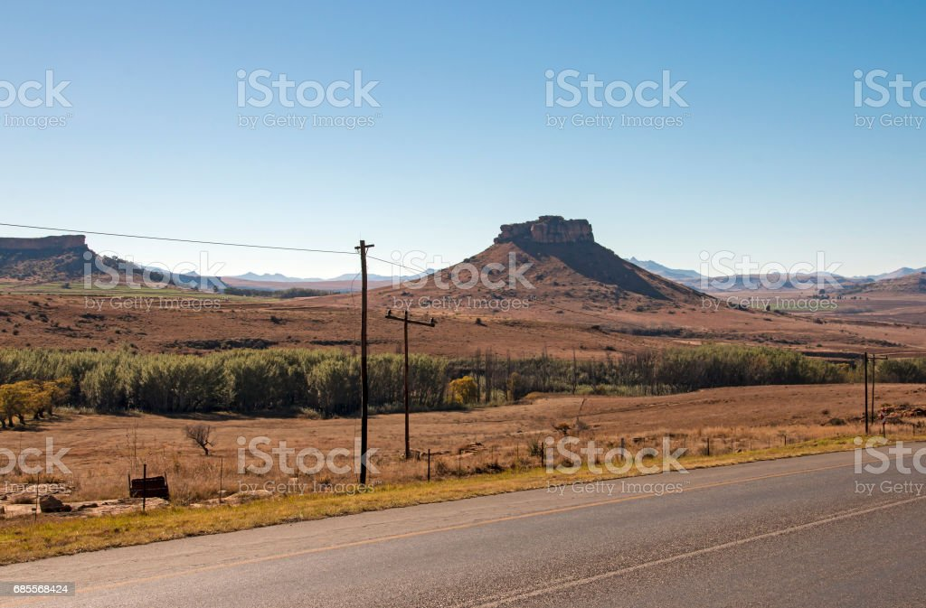 Asphalt Road Running Through Dry Winter Landscape in South Africa royalty-free 스톡 사진