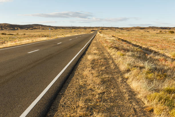 asphalt road Sainshand Zamiin-Uud in Mongolia asphalt road Sainshand Zamiin-Uud in Mongolia, Gobi Desert steppe stock pictures, royalty-free photos & images