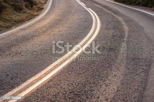 833130962 istock photo asphalt road textured perspective surface with marking in corner of picture transportation and infrastructure background pattern with empty copy space for text or inscription 1203760388