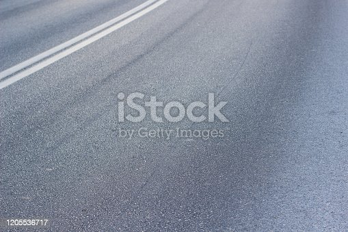 833130962 istock photo asphalt road textured perspective surface with marking in corner of picture transportation and infrastructure background pattern with empty copy space for text or inscription 1205536717