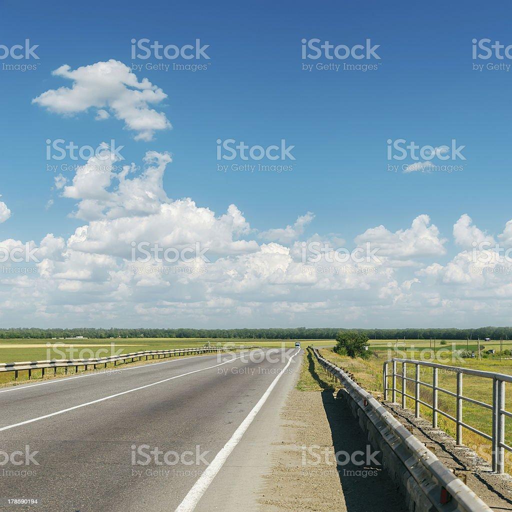 asphalt road to cloudy horizon royalty-free stock photo